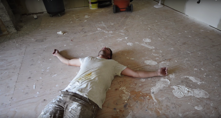 Samiurai-carpenter-laying-in-mud-on-the-subfloor.png