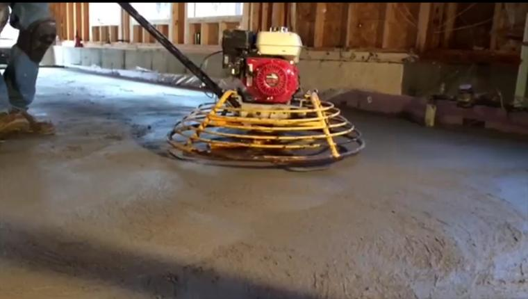 Image of power trowel on a concrete slab